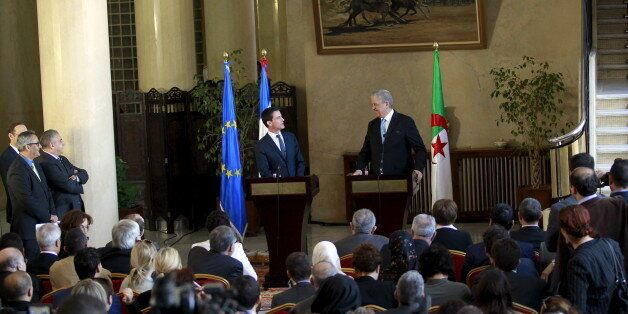 French Prime minister Manuel Valls (L) talks to the press during a news conference with Algerian Prime...