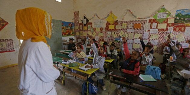 An indigenous Sahrawi teacher attends teaches at a school in Boudjdour desert refugee camp in Tindouf,...