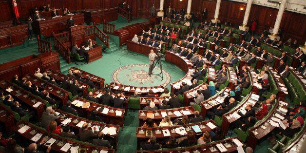 Tunisia's Prime Minister-designate Habib Essid delivers a speech in the parliament to present his government...