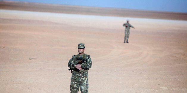 Soldiers stand guard at Krechba gas treatment plant, about 1200 km (746 miles) south of Algiers December...