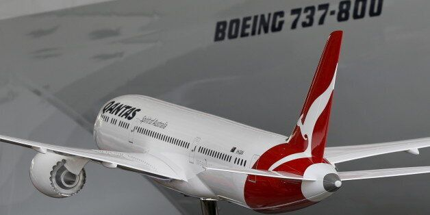A model of a Boeing 787-9 Dreamliner in Qantas livery is shown during an event marking the 95th anniversary...