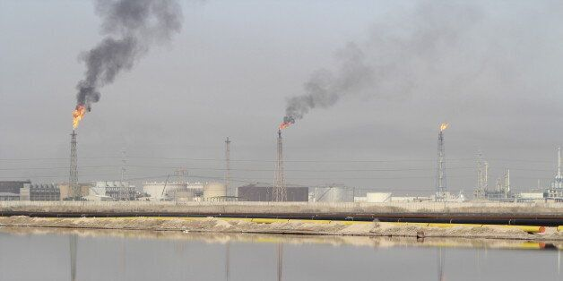 A general view shows a lake of oil at Al-Sheiba oil refinery in the southern Iraq city of Basra, in this...