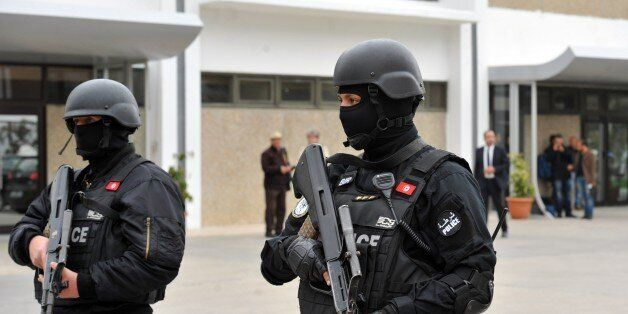 Members of Tunisian special forces stand guard outside Tunis-Carthage International airport on March...