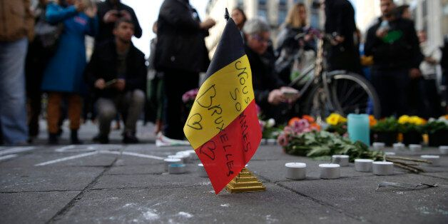 A Belgian flag reading 'We are all Brussels' stands at a makeshift memorial at Place de la Bourse (Beursplein)...