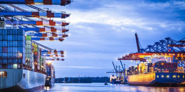 Container terminal with huge container cargo ship ready for