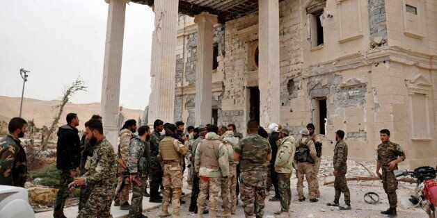 Forces loyal to Syria's President Bashar al-Assad gather at a palace complex on the western edge of Palmyra...