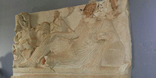 A view shows a damaged artefact at the museum of the historic city of Palmyra, after forces loyal to...