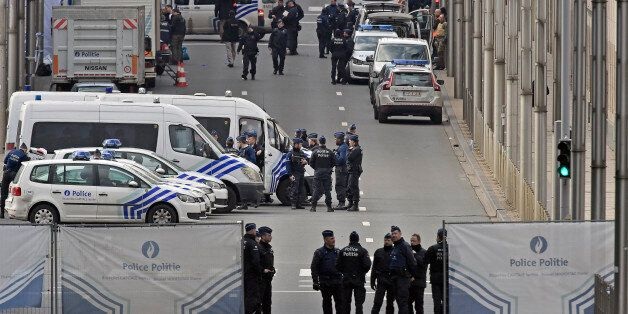 Police secure the metro station Maelbeek in Brussels, Tuesday, March 22, 2016. Explosions, at least one...