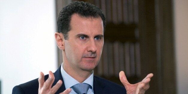 Syria's President Bashar al-Assad speaks during an interview with Russia's RIA news agency, in Damascus,...