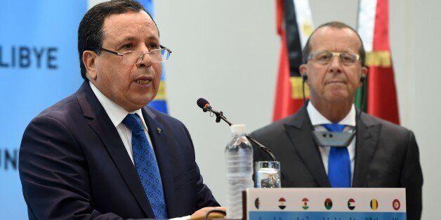 CORRECTION - UN envoy for Libya, Martin Kobler (L) speaks next to Tunisian Foreign Affairs Minister Khemais...
