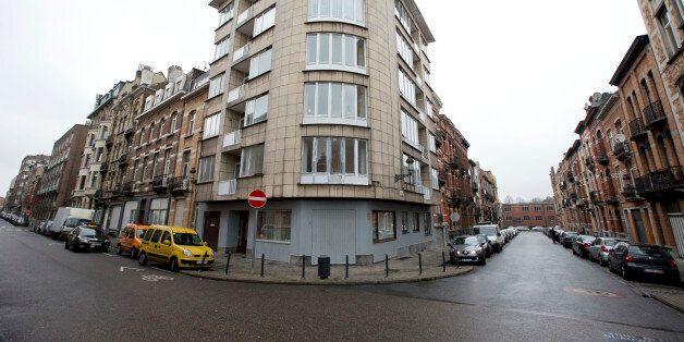 The apartment complex which was raided by police on Tuesday night after twin bomb attacks, center, is...