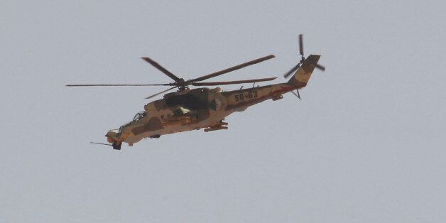An Algerian military helicopter flies over Amenas city, south east of Algiers, where Islamist militants...