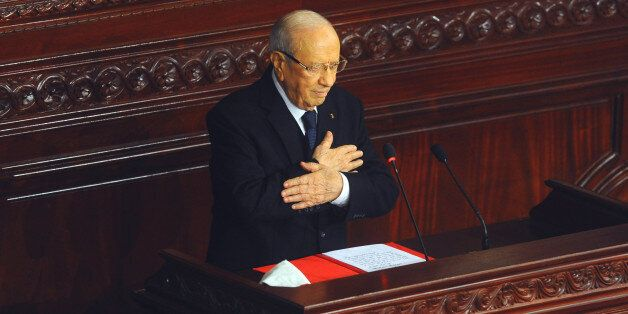 Beji Caid Essebsi, acknowledges the applauses after swearing in as new Tunisian President during a ceremony...
