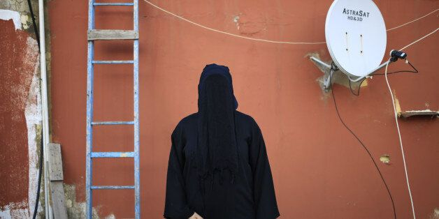 This Friday, May 1, 2015 shows a 32-year old Lebanese woman, whose father is a Shiite Muslim and mother...