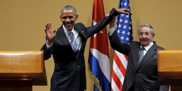 U.S. President Barack Obama and Cuban President Raul Castro gesture after a news conference as part of...