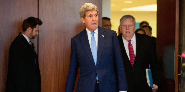 Secretary of State John Kerry, accompanied by US Ambassador to Russia John Tefft, right, arrives to meets...