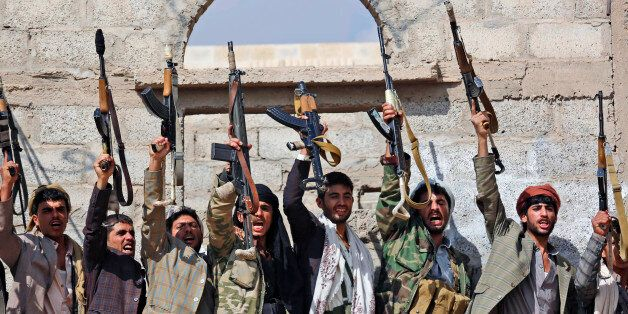 FILE - In this Dec. 15, 2015, file photo, Shiite tribesmen, known as Houthis, hold their weapons as they...