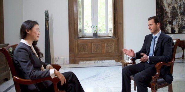 Assad pour un gouvernement de transition rassemblant pouvoir et