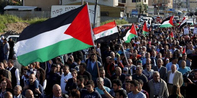 Israeli Arab demonstrators take part in a Land Day rally in the northern Israeli village of Arrabe March...