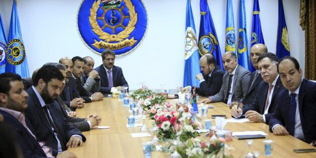 Fayez Seraj, Libyan prime minister-designate under the proposed unity government, attends a meeting with...