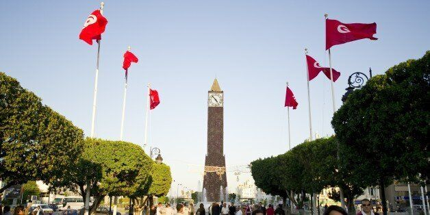 Tunisians flags fly on October 19, 2011 on a street leading to the Clock square in the center of Tunis....