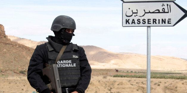A Tunisian police stands with a weapon near a mountain in Kasserine October 23, 2014. The Chaambi, Saloum...