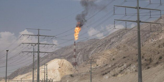 Waste gasses are burnt off at the South Pars Gas field in Asalouyeh Seaport, north of Persian Gulf, Iran...