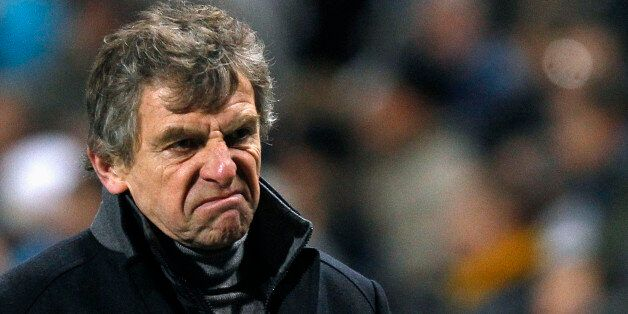 Lorient's head coach Christian Gourcuff reacts on the pitch at half-time during his French Ligue 1 soccer...