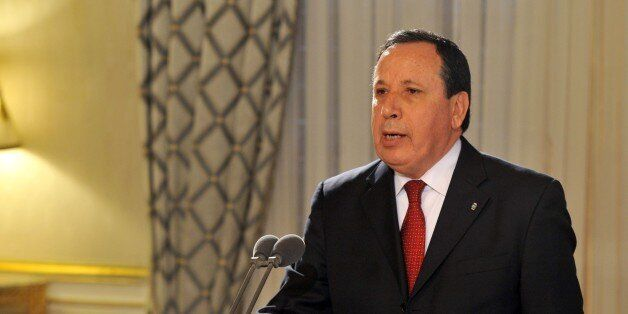 Tunisian new foreign minister Khemaies Jhinaoui takes an oath during a ceremony after the adoption of...