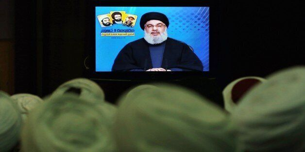 FILE- In this Tuesday, Feb. 16, 2016 file photo, Shiite and Sunni clerics listen to Hezbollah leader...