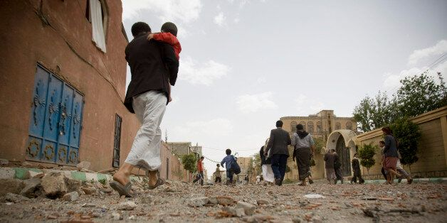 FILE - In this Wednesday, April 8, 2015 file photo, people flee after a Saudi-led airstrike in Sanaa,...