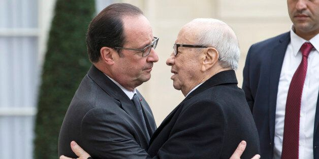 French President Francois Hollande, left, welcomes Tunisia's President Beji Caid Essebsi at the Elysee...