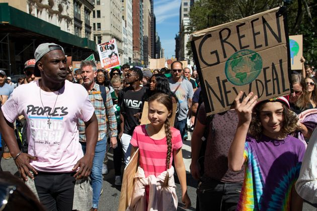 Swedish environmental activist Greta Thunberg, center, takes part during the Climate Strike, Friday,...