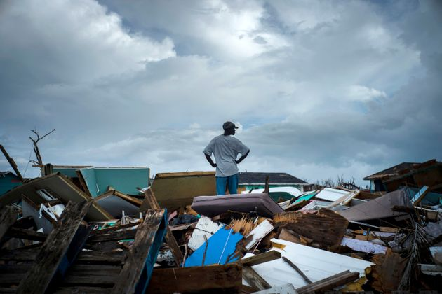 A man stands on the rubble of his home in the Haitian Quarter, after the passage of the Hurricane Dorian...