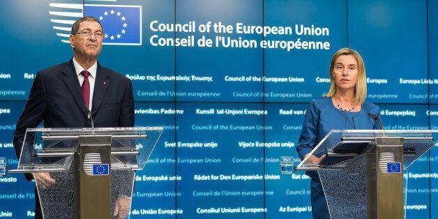 European Union High Representative Federica Mogherini, right, and Tunisia's Prime Minister Habib Essid...