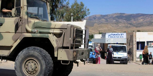 A military truck parks outside the hospital of Kasserine, near the Algerian border, Thursday, July 17,...