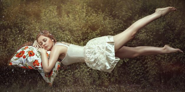 Levitation girl on a bed in a sweet