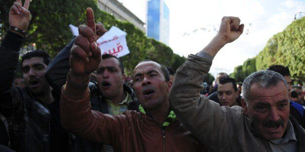 Unemployed tunisian people stage a protest in a precarious calm enforced by a nationwide curfew in Habib...