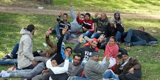 Unemployed Tunisians sit at el-Mourouj park after took part in a 400 kilometres march from the city of...