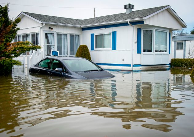 A car is seen here submerged in floodwaters in the Montreal suburb of Sainte-Marthe-sur-le-Lac, Que.,...