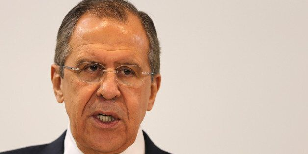 Russian Foreign Minister Sergey Lavrov talks during a press conference with his UAE counterpart Sheikh...