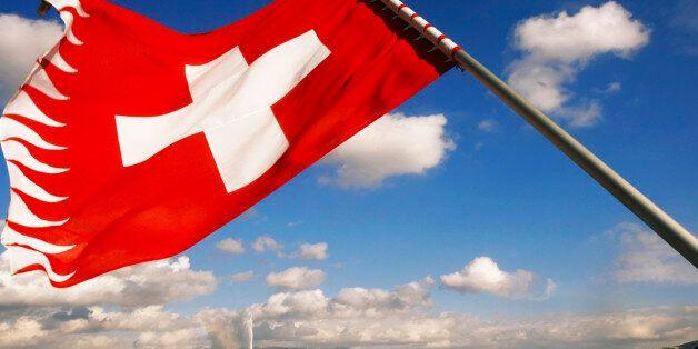 Switzerland, Geneva, Lake Geneva, Swiss flag in