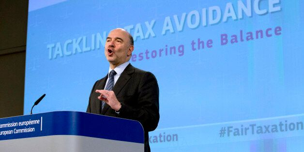 European Commissioner for Economic and Financial Affairs Pierre Moscovici speaks during a media conference...