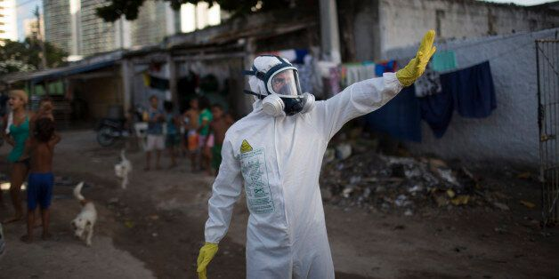 A municipal worker gestures during an operation to combat the Aedes aegypti mosquitoes that transmits...