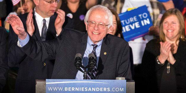 Democratic presidential candidate, Sen. Bernie Sanders, I-Vt, smiles as he speaks at his primary night...