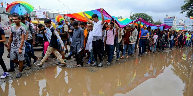 Members and supporters of lesbian, gay, bisexual and transgender community, hold a large rainbow flag...