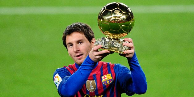 FC Barcelona's Lionel Messi, from Argentina, holds his Ballon d'Or (Golden Ball) award as European Footballer...