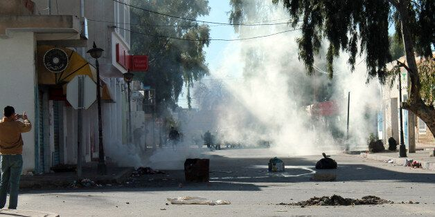 Tunisian protesters take the streets in the southern town of Kasserine , Tunisia, and clash with riot...
