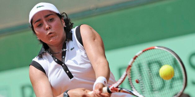Ons Jabeur of Tunesia returns against Monica Puig of Puerto Rico in the girls singles final of the French...