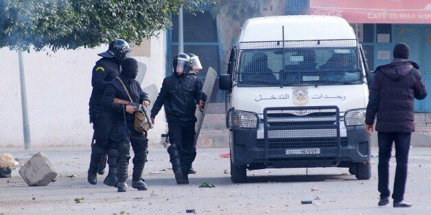 Tunisian riot policemen deploy during clashes following protests after the death of an unemployed man...